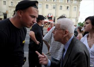 A Belarusian policeman argues with a man trying to reach the protest area in Minsk, 15 June