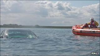 Car under water on Holy Island causeway
