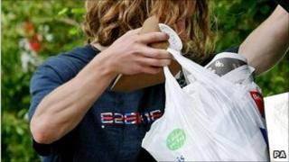 Man emptying rubbish into bin