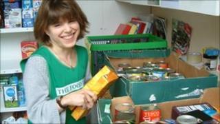 Woman sorting donated food