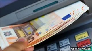 ATM machine dispensing notes
