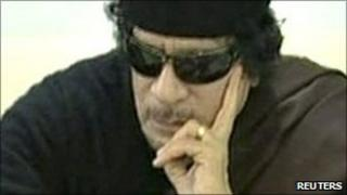 Muammar Gaddafi plays chess with Kirsan Ilyumzhinov, the president of the international chess federation, in Tripoli on 12 June, 2011 in a still image taken from Libyan state TV broadcast