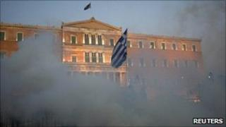 Tear gas clouds surround the Greek parliament