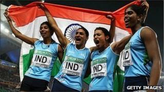 The 4x400 relay team - (left to right) Ashwini Akunji, Manjeet Kaur, Mandeep Kaur, Sini Jose - celebrate winning India's first Commonwealth track gold since 1958