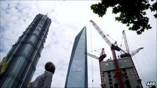 The 101-storey World Finance Center (C) in the Pudong financial district in Shanghai, on June 29, 2011