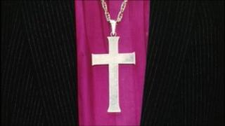 Cross and clothing of Church of England bishop