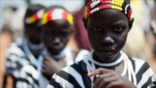 Young Sudanese girls in traditional dress participate in a march organised by the Sudan People's Liberation Movement in Juba on 5 July