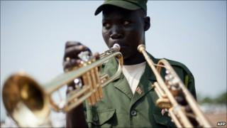 A South Sudanese soldier plays the trumpet during a parade rehearsal in Juba on 7 July 2011