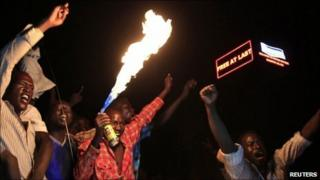 "People take part in South Sudan""s independence day celebrations near the countdown clock in Juba on 9 July 2011"