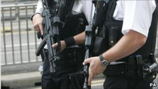 Armed policemen at Heathrow Airport