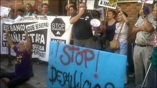 """The flashmob protesters with signs that read """"Stop evictions!"""""""