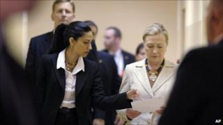 Hillary Clinton with aide Huma Abedin, and rear left security chief Kurt Olsson