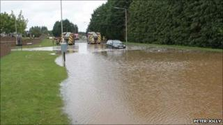 Driver trapped in floods on Barn Church Road, Inverness. Photo by Peter Jolly