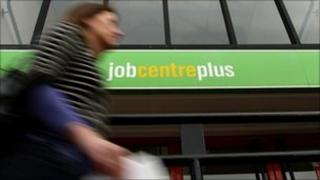 Woman walking past jobcentre
