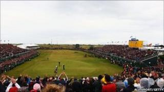Darren Clarke of Northern Ireland celebrates victory on the 18th green during the final round of The 140th Open Championship at Royal St George's
