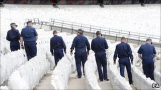 Police officers at the Olympic Stadium in Stratford, east London