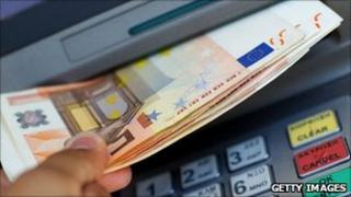 Eurozone notes being withdrawn from an ATM