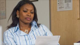 Funmi Wale-Adegbite looks through an application