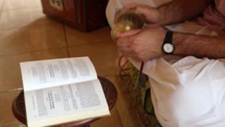 A devotee of Lord Krishna reads the Bhagvad Gita