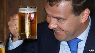 Russian President Dmitry Medvedev raises a glass with German Chancellor Angela Merkel (file image)