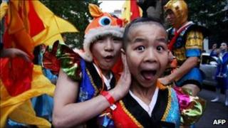 Young performers fool around prior to the start of the Chinese New Year Twilight Parade on 21 February, 2010 in Sydney