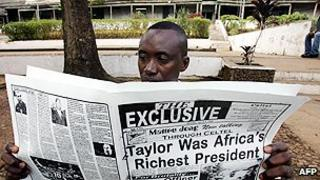 Newspaper reader in Sierra Leone