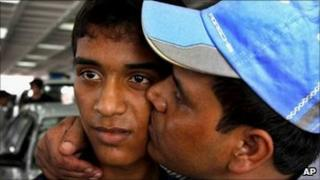 One of the Bangladeshis held by kidnappers in Afghanistan kisses his son as he arrives in Dhaka on Sunday 7 August 2011