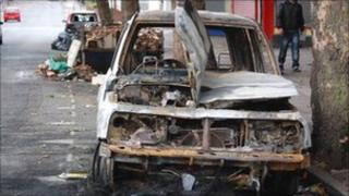 A burnt out car in Grove Lane