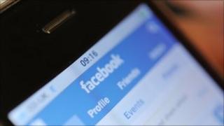 An iPhone displaying facebook