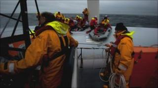Twenty-one crew members were rescued by the RNLI after the yacht Rambler 100 overturned during the Fastnet race