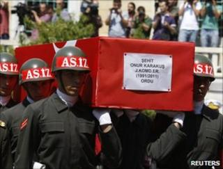 Turkish soldiers at a funeral in Istanbul on 15 August bear the coffin of a comrade killed in a PKK attack two days earlier