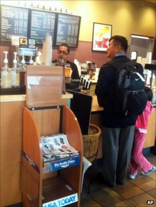 Gary Locke, pictured in Seattle, ordering coffee with his daughter on 12 August 2011