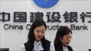 China Construction Bank employees at a branch in Hong Kong