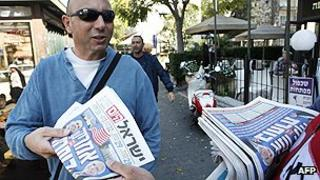 Newspaper reader in Israel