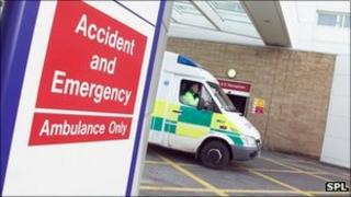 Ambulance leaving Accident and Emergency outside a hospital