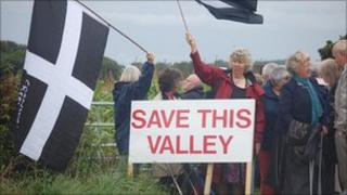 Demonstrators by the proposed site