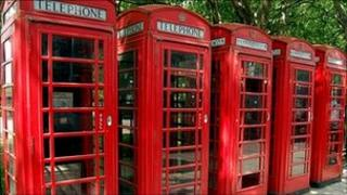 A row of red telephone boxes in central London