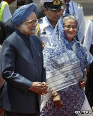 Bangladesh Prime Minister Sheikh Hasina, right, escorts Indian Prime Minister Manmohan Singh after receiving him at the airport in Dhaka, Bangladesh, Tuesday, Sept. 6, 2011.