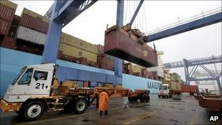 Cargo container being loaded onto a ship in Boston