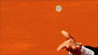 Coin being tossed at the Madrid tennis open