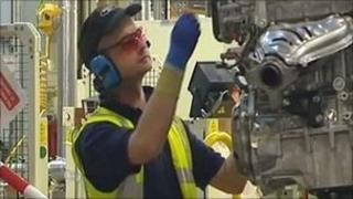 A worker at the Toyota plant in Deeside where a new zone is being created