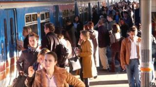 Passengers at train station