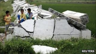 Villagers from Longtou in Lufeng play on the rubble of a surrounding wall after it was torn down by villagers earlier in the week on 24 September 2011.