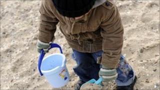Boy digging in sand