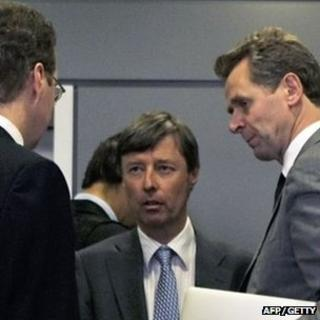 International Monetary Fund's Paul Thomsen (R) talks with European Commission official Matthias Mors (C) and another troika official after their meeting with Greek Finance Minister Evangelos Venizelos in Athens on 30 September 2011
