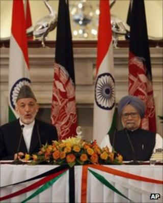 File picture President Hamid Karzai (left) and Indian PM Manmohan Singh
