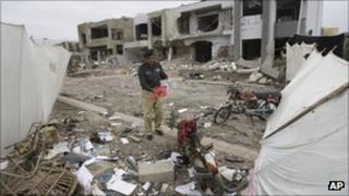 Policeman at the scene of a bombing in Karachi in September 2011