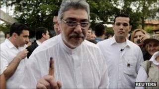 Paraguayan President Fernando Lugo displays his inked finger after voting in Asuncion