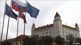 Slovak and European Union flags fly next to Bratislava Castle