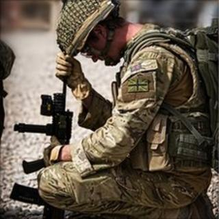 A British soldier on patrol in Afghanistan